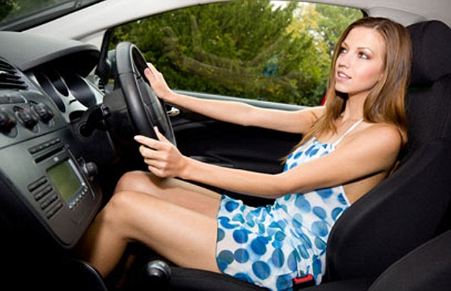 Girl driving car without seatbelt
