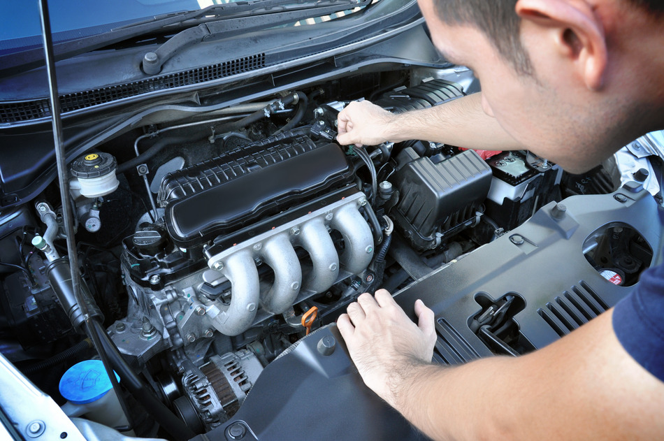 A man checking car engine
