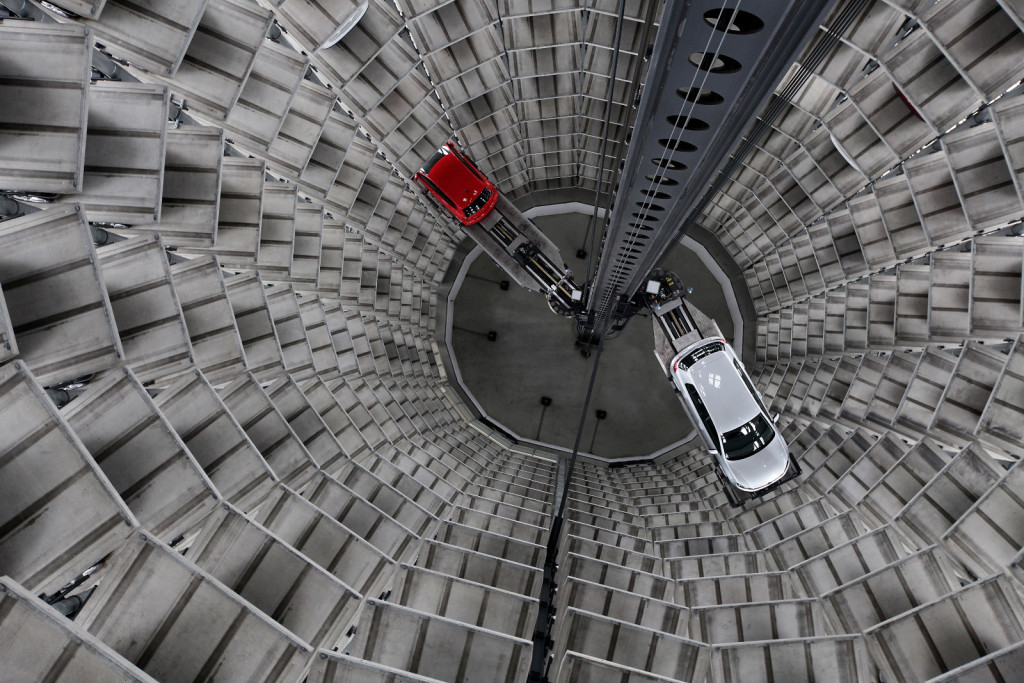 WOLFSBURG, GERMANY - MARCH 11:  Cars by German automaker Volkswagen AG are deposited into one of two storage towers at the Autostadt customer reception center at the Volkswagen factory on the day of VW's annual press conference on March 11, 2010 in Wolfsburg, Germany. VW Chairman Martin Winterkorn admitted that VW had been affected by the worldwide financial crisis in 2009, though reported that many of VW's brands reported growth, especially in China. VW customers who come to Wolfsburg to pick up their car in person receive their new car after a robot extracts the car from one of the two towers and brings it to them via an automated, underground transport system. Each of the two towers hold 400 cars.  (Photo by Sean Gallup/Getty Images)