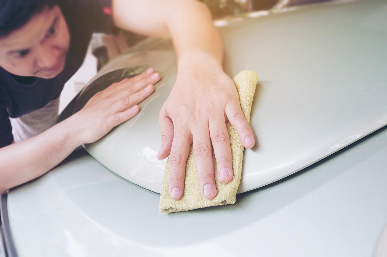 A man wiping his car