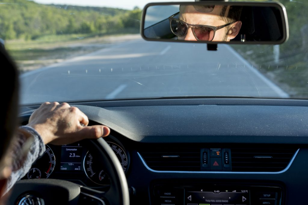 Man driving with sunglasses