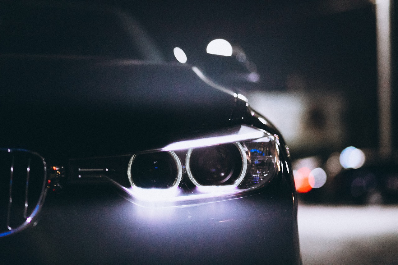 Close up of a car's headlights on during the night