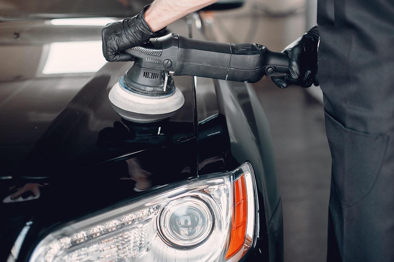 a man polishing his car