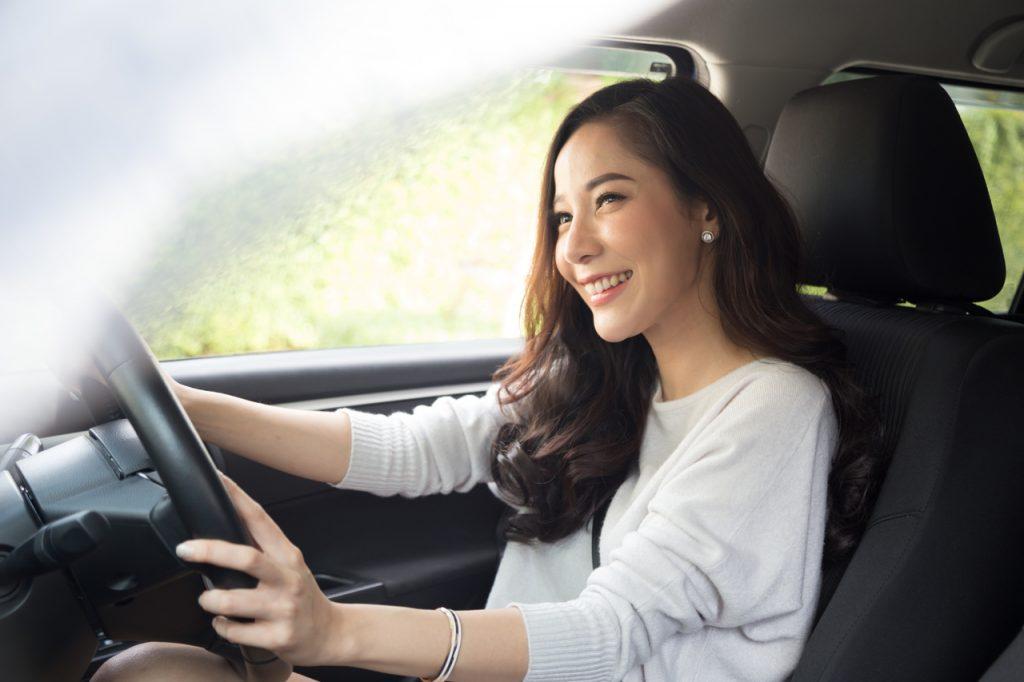 An asian woman driving her car