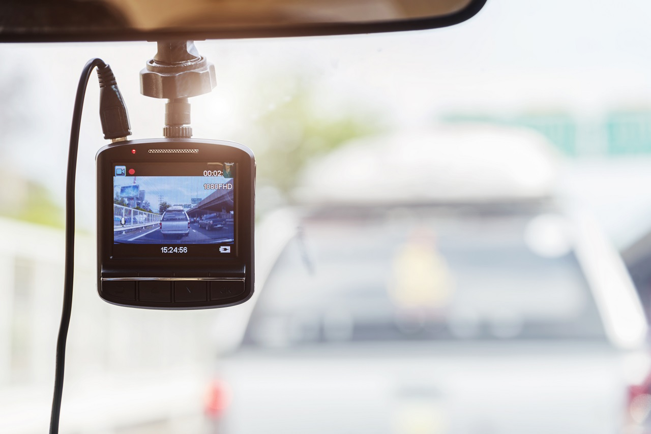 A dashcam on a car windshield