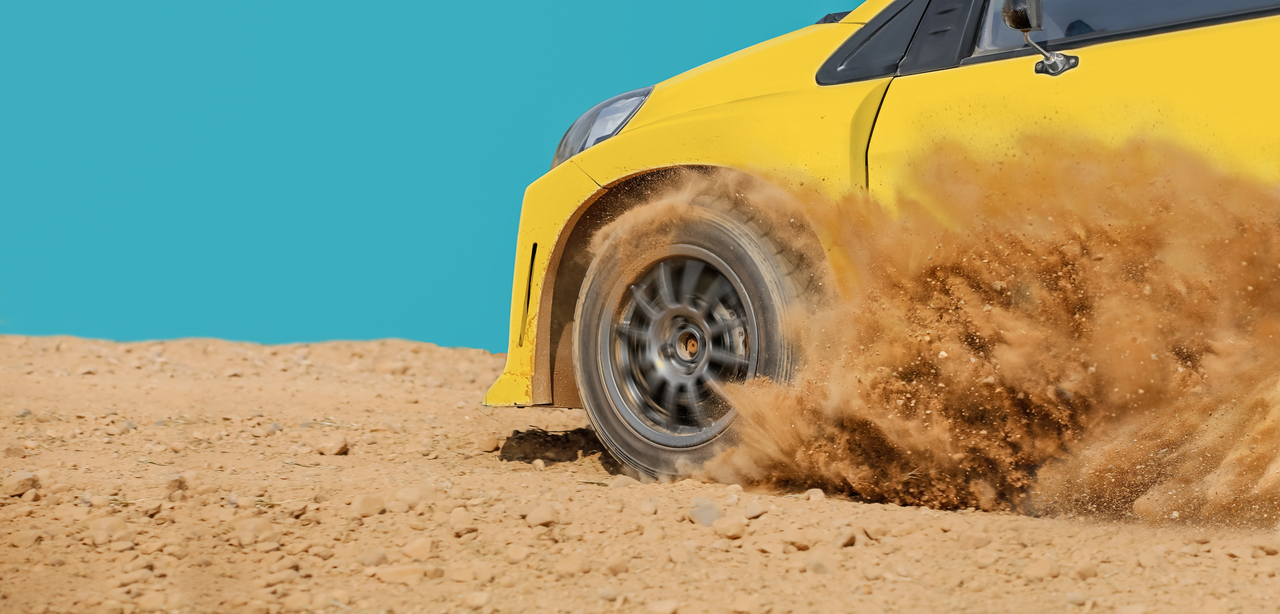 A car driving fast through the dirt