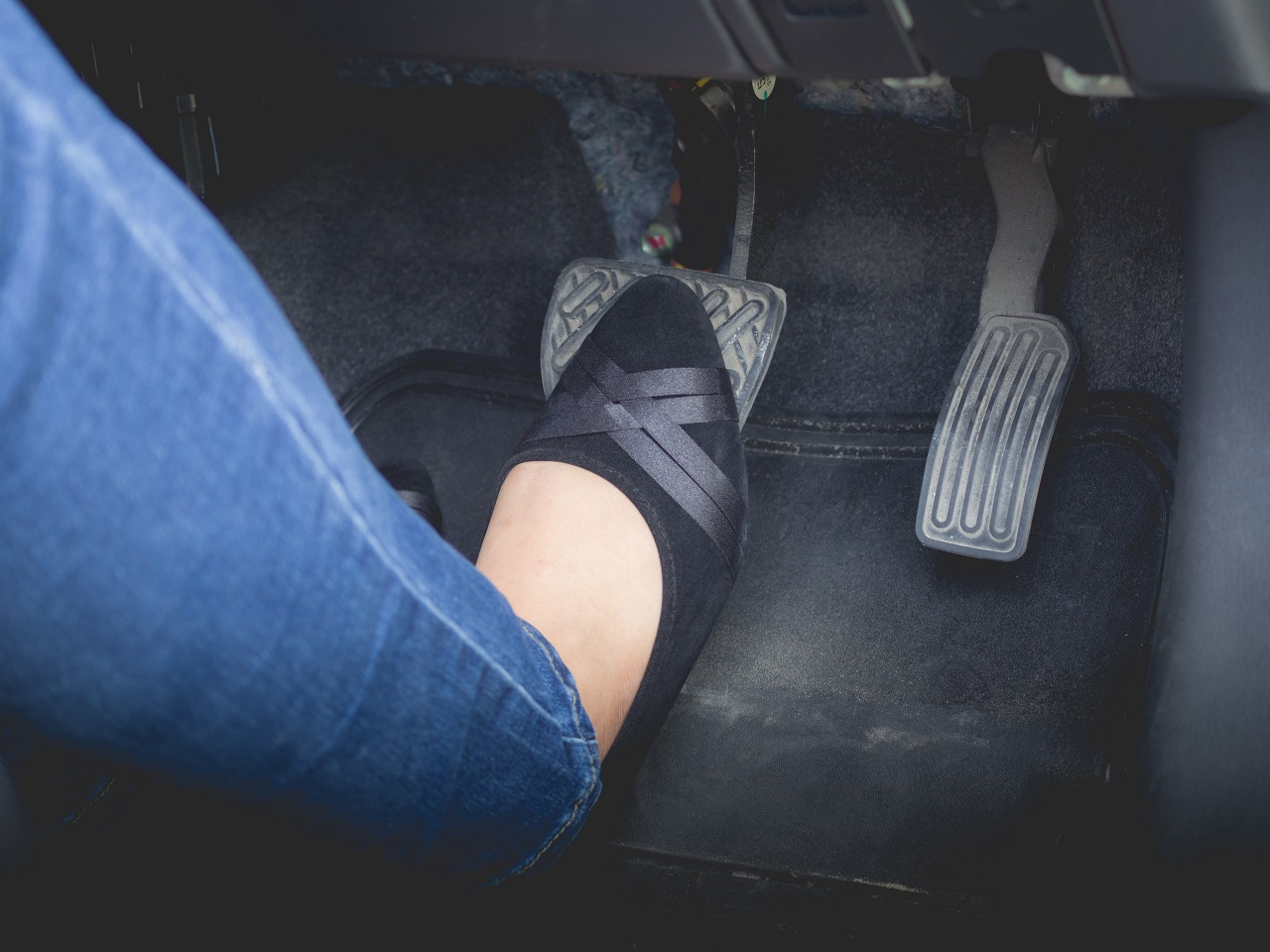 A woman's foot on the brake pedal