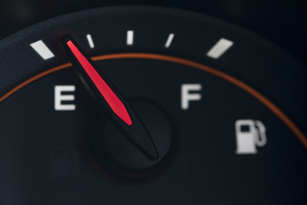 Close up of a car dashboard with empty gas