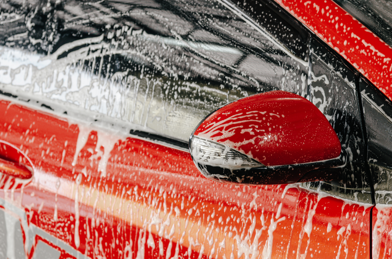 A red car being cleaned