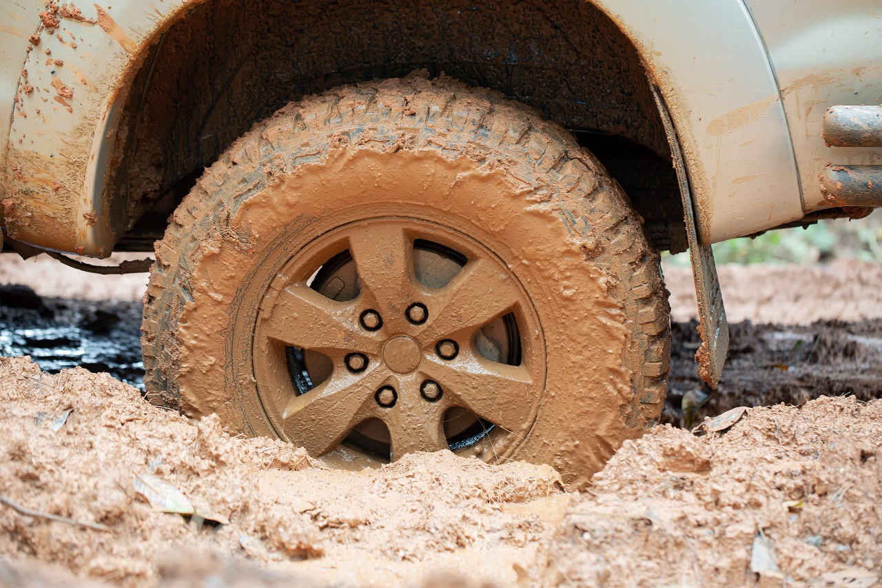 A car tire stuck in mud
