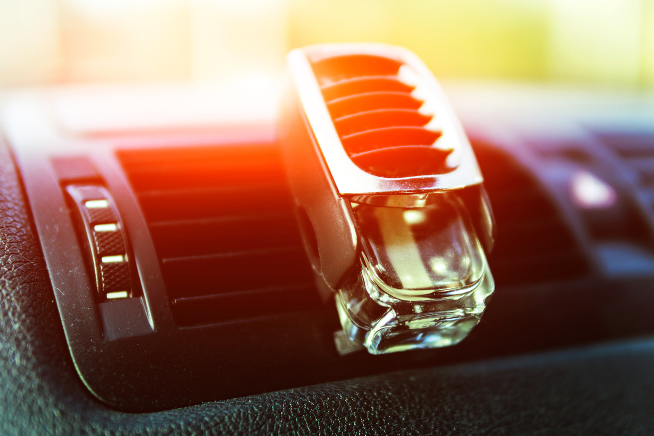 A car's aircon with a scent freshener