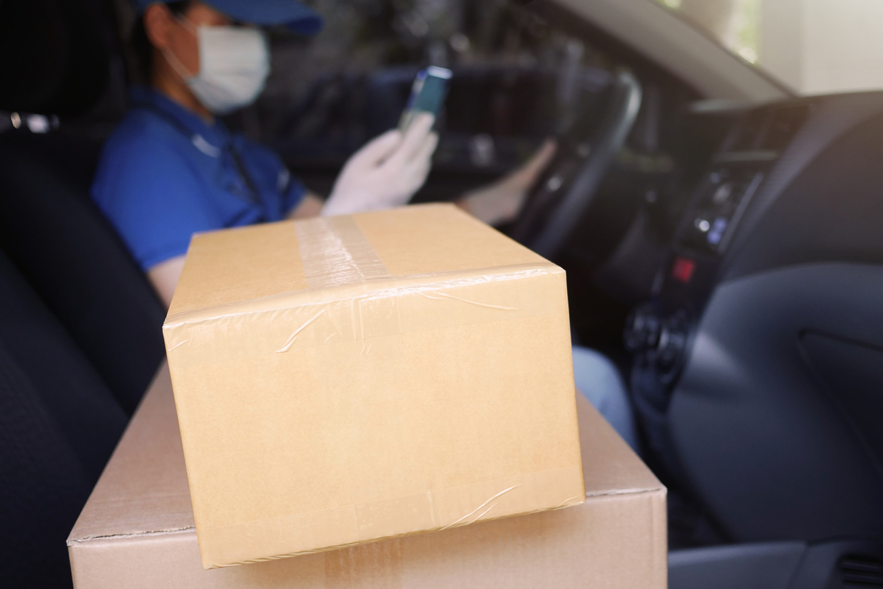A woman with boxes in her passenger seat