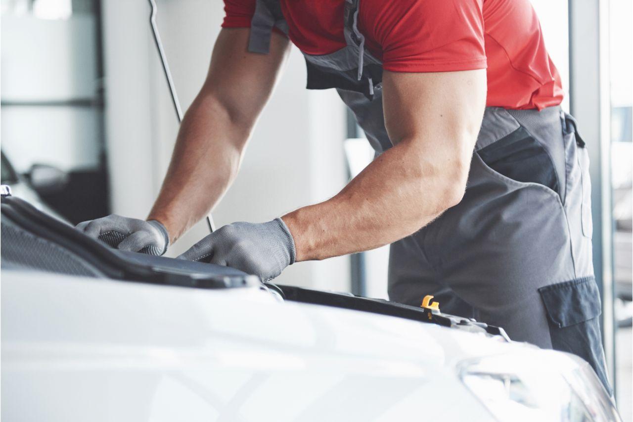 A car mechanic fixing a car radiator