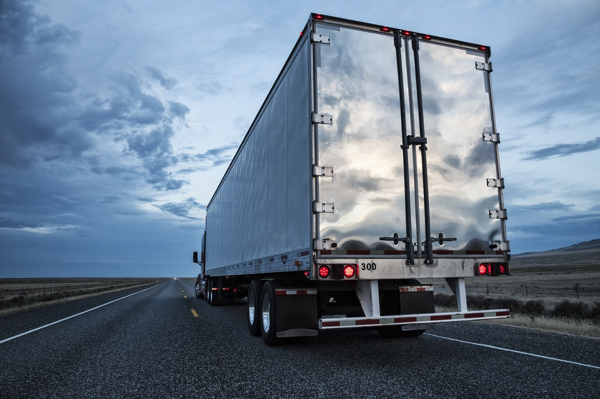 Rear view of the trailer on a Class 8 commercial truck on the highway.